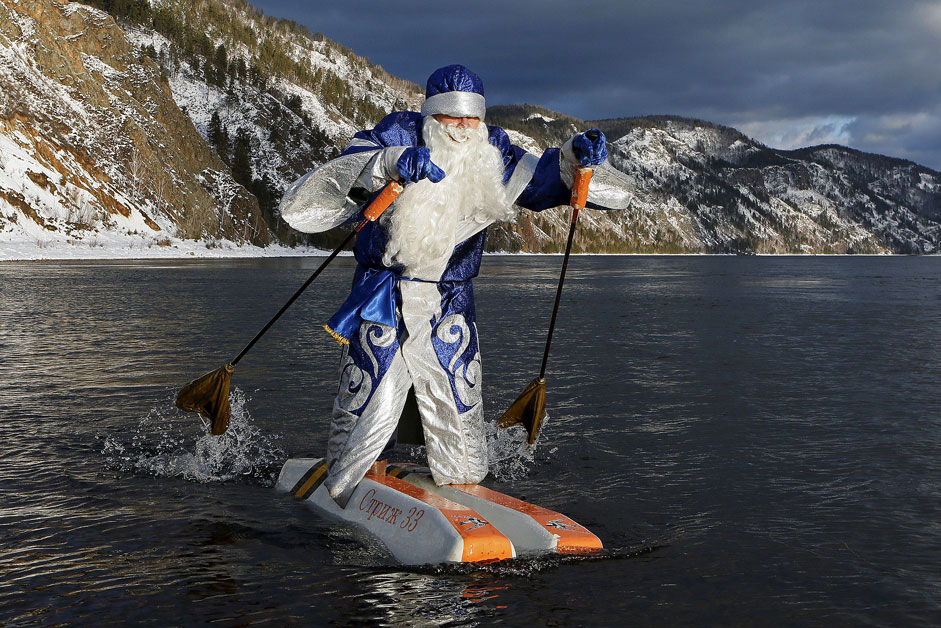 Nikolai Vasilyev, 62, dressed as Father Frost, Russian equivalent of Santa Claus, water-skis along the Yenisei River outside Siberian city of Krasnoyarsk, Russia. Vasilyev, a teacher of the Krasnoyarsk Aerospace Academy, constructed the self-made water skis to travel on the water surface. The skis are made of plastic foam and the sticks are designed to propel him forward.