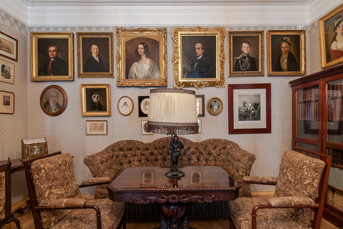 """The portrait on the wall (third from the left) depicts the poet's wife, Ernestina Tyutcheva, """"a woman of splendid beauty and intellect"""", as she was described by contemporaries. The portrait was made by Friedrich Durk in 1840."""