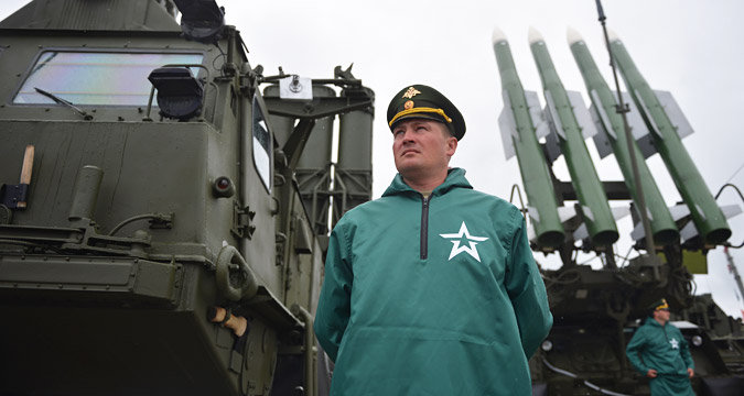 Serviceman in front of the anti-missile S-300 system at the ceremony of opening the ARMY-2015 international forum in the military park Patriot, in the town of Kubinka, Moscow Region, June 16, 2015.