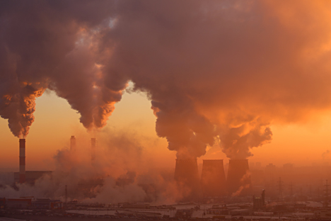 Polluting factory at dawn.