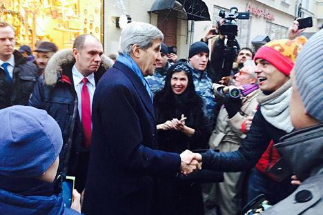 U.S. Secretary of State John Kerry walks on Arbat Street in Moscow.