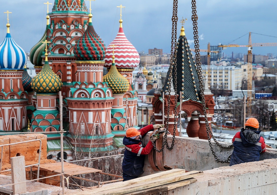MOSCOW, RUSSIA. DECEMBER, 2015. Workers seen during a demolition of Building 14, the Presidium, between the Spasskaya Tower and the Senate Building of the Moscow Kremlin.