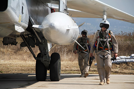 Russian pilots near a Su-24 aircraft before a mission, at the Khmeimim airbase in Syria.