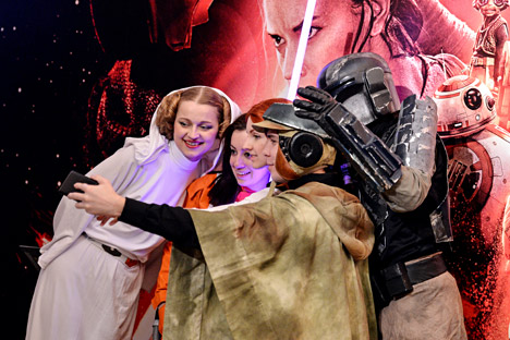 Visitors at the premiere of the movie Star Wars: The Force Awakens, at the Karo 11 Oktyabr movie theater in Moscow.
