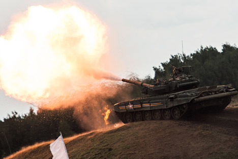"A T-90 tank participates in the specialized military equipment show held as part of the ""Invincible and Legendary"" military patriotic program during the Engineering Technologies 2014 international forum in Zhukovsky near Moscow."