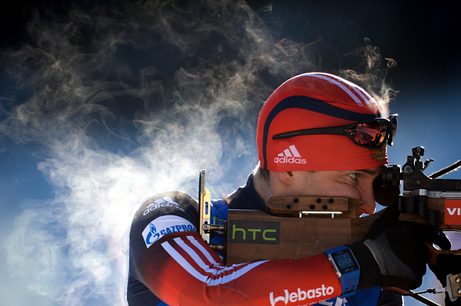OKLJUKA, SLOVENIA. DECEMBER 17, 2015. Russia's Evgeniy (Yevgeny) Garanichev takes aim as he competes to win bronze in the men's 10km sprint at the 2015/2016 IBU World Cup Biathlon