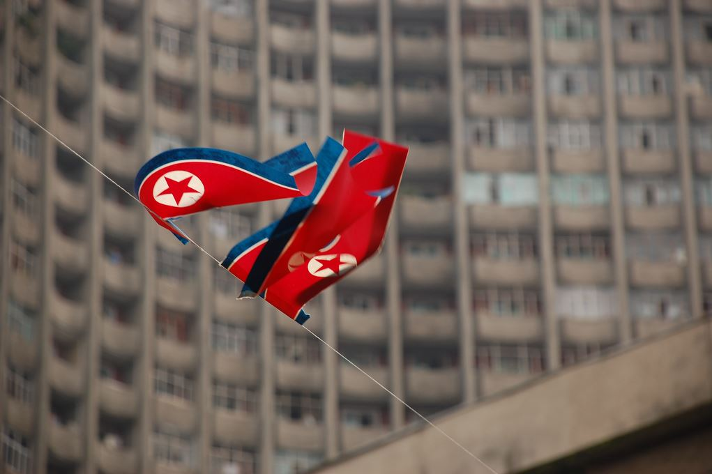 The flag of the Democratic People's Republic of Korea on a building in Pyongyang.