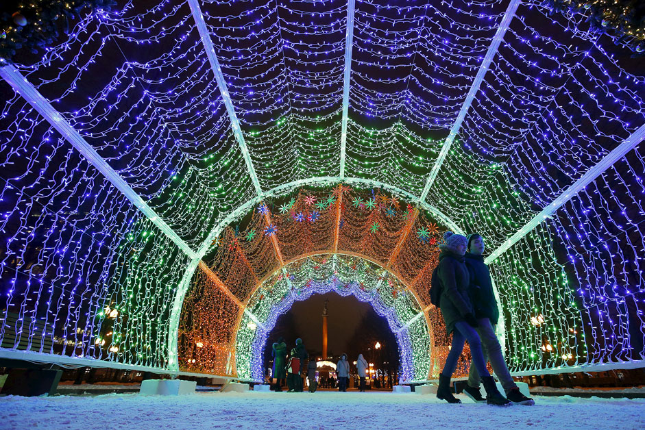 A couple walks through decorations for the upcoming Christmas and New Year celebrations in central Moscow, Russia