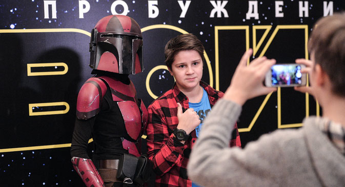 Visitors taking pictures at the premiere of the movie Star Wars: The Force Awakens, at the Karo 11 Oktyabr movie theater in Moscow.