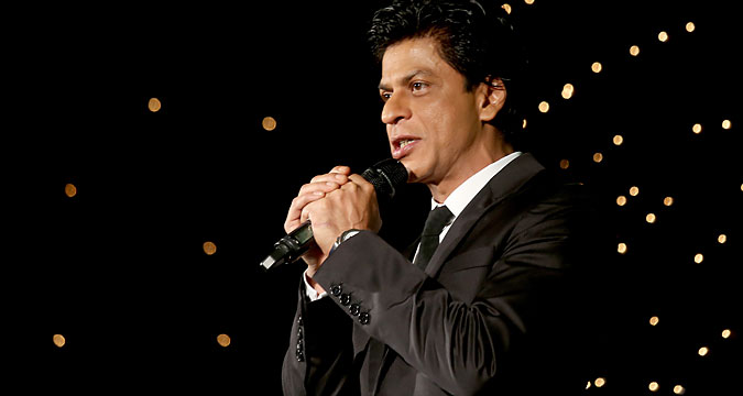 Indian Bollywood actor Shah Rukh Khan gives a speech during a promotional event in Bangalore, India, 11 December 2015.