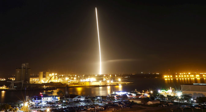 The first stage of the SpaceX Falcon 9 rocket returns to land in a time exposure at Cape Canaveral Air Force Station, on the launcher's first mission since a June failure, in Cape Canaveral, Dec. 21, 2015.