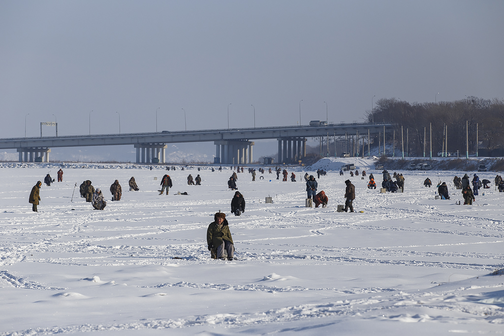 Fishermen on the icy surface of the sea.