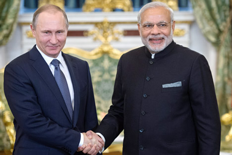 Russian President Vladimir Putin and Indian Prime Minister Narendra Modi meet in the Kremlin.