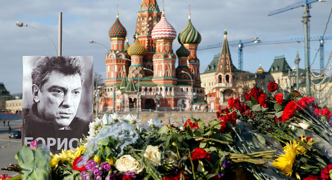 A portrait of Kremlin critic Boris Nemtsov and flowers are pictured at the site where he was killed on February 27, with St. Basil's Cathedral seen in the background, at the Great Moskvoretsky Bridge in central Moscow March 6, 2015. Nemtsov, 55, was shot dead meters from the Kremlin as he was walking home.