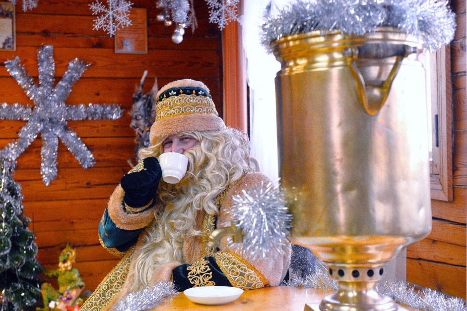 Tatar father Frost, Kysh Babay, drinks tea at his residence in the village of Yana Kyrlay, Arsky District in the Republic of Tatarstan.