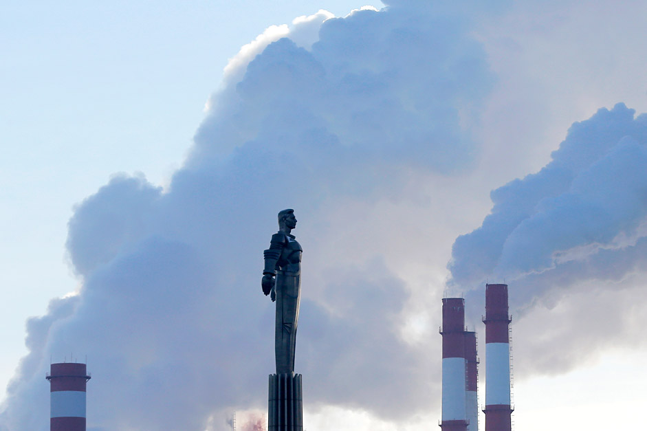 Steam rises from chimneys of a heating power plant near a monument of Yuri Gagarin, the first man in space, on a frosty winter day in Moscow, Russia