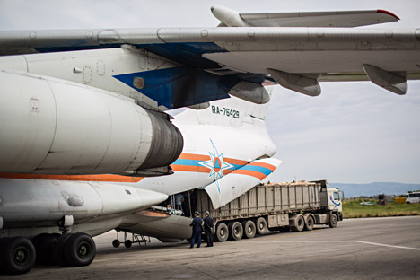 Russia has started humanitarian operation in Syria. Pictured: Russian EMERCOM plane with humanitarian aid arrives to Latakia Airport in Syria, 2014.