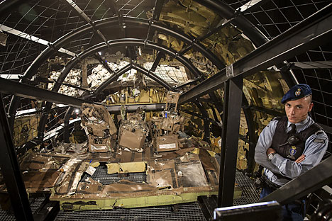 A military policeman stands guard in the cockpit of the MH17 airplane after the presentation of the final report into the crash of July 2014 of Malaysia Airlines flight MH17 over Ukraine, in Gilze Rijen, the Netherlands, October 13, 2015.