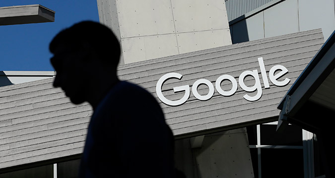 Consultations on a settlement agreement with Google continue despite the announcement, said FAS press service. Photo: A man walks past a building on the Google campus in Mountain View, Calif.