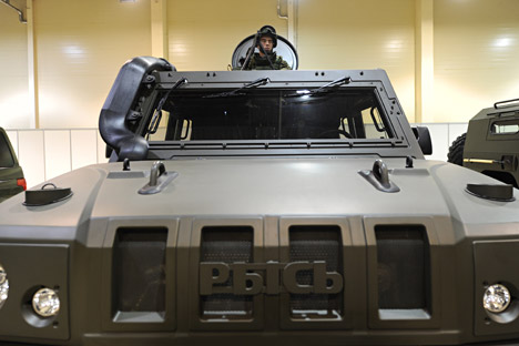 A serviceman in a light multirole armoured vehicle Lynx.