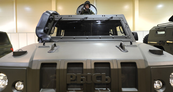A serviceman in a light multirole armoured vehicle Lynx at the exhibition Innovations Day of the Southern Military District in Rostov-on-Don.