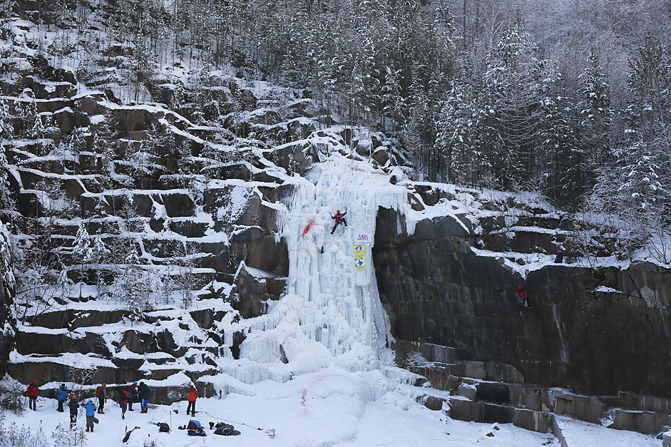 "People take part in a regional ice climbing and winter rock climbing championship at the ""Stolby"" (Rock Pillars) national natural reserve, with the air temperature at about minus 20 degrees Celsius (minus 4 degrees Fahrenheit), outside Krasnoyarsk, Siberia, Russia, January 24, 2016."