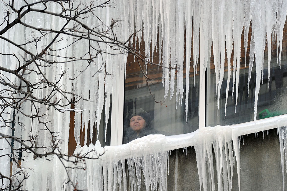 Frost and icicles on houses in Ryazan