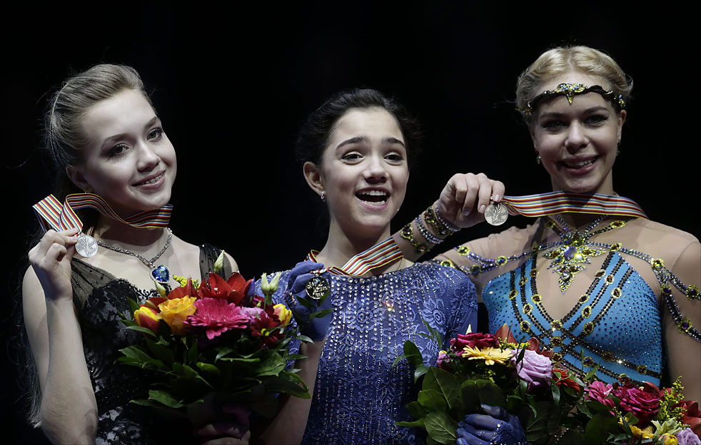 From left, Elena Radionova, Evgenia Medvedeva and Anna Pogorilaya, all of Russia, show off their silver, gold and bronze medals after the ladies' program at the European figure skating championships in Bratislava, Slovakia