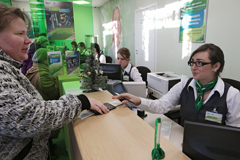 A client at a multi-purpose branch of the Sberbank of Russia, in St. Petersburg.