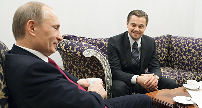 Russia's Prime Minister Vladimir Putin listens to actor Leonardo DiCaprio during their meeting, dedicated to International Tiger Forum, in St. Petersburg, November 23, 2010.