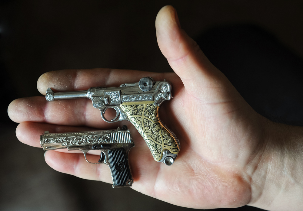 TULA, RUSSIA. FEBRUARY 8, 2016. Miniature replicas of pistols made by Tula craftsman Andrei Batashov