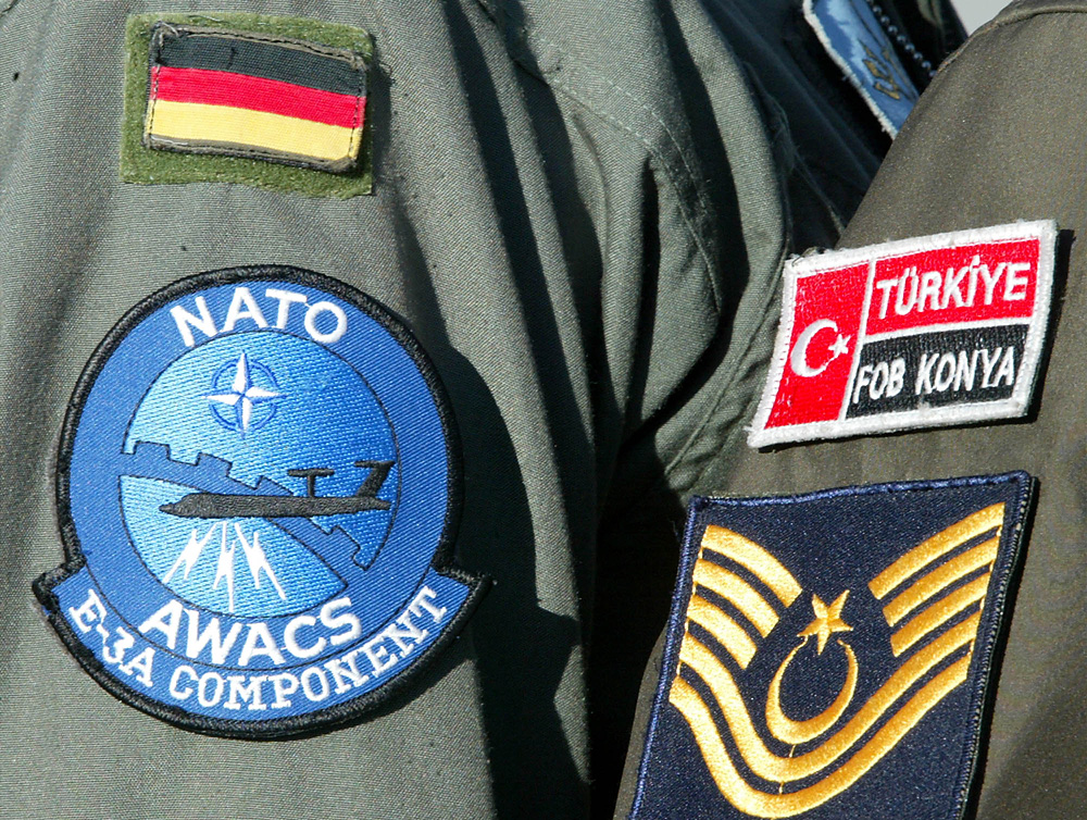 A Turkish NATO MP guards together with a German crew member one of three AWACS planes, based at the Forward Operation Base in Konya, Turkey.