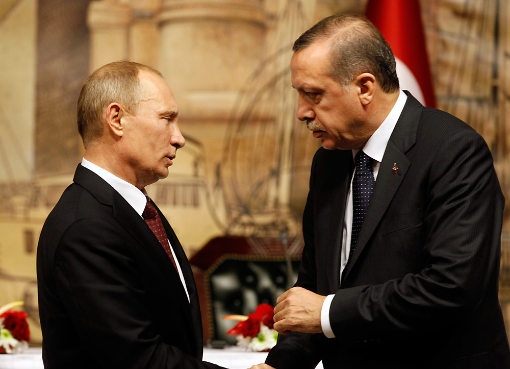 Vladimir Putin talks with Tayyip Erdogan after their news conference in Istanbul December 3, 2012.