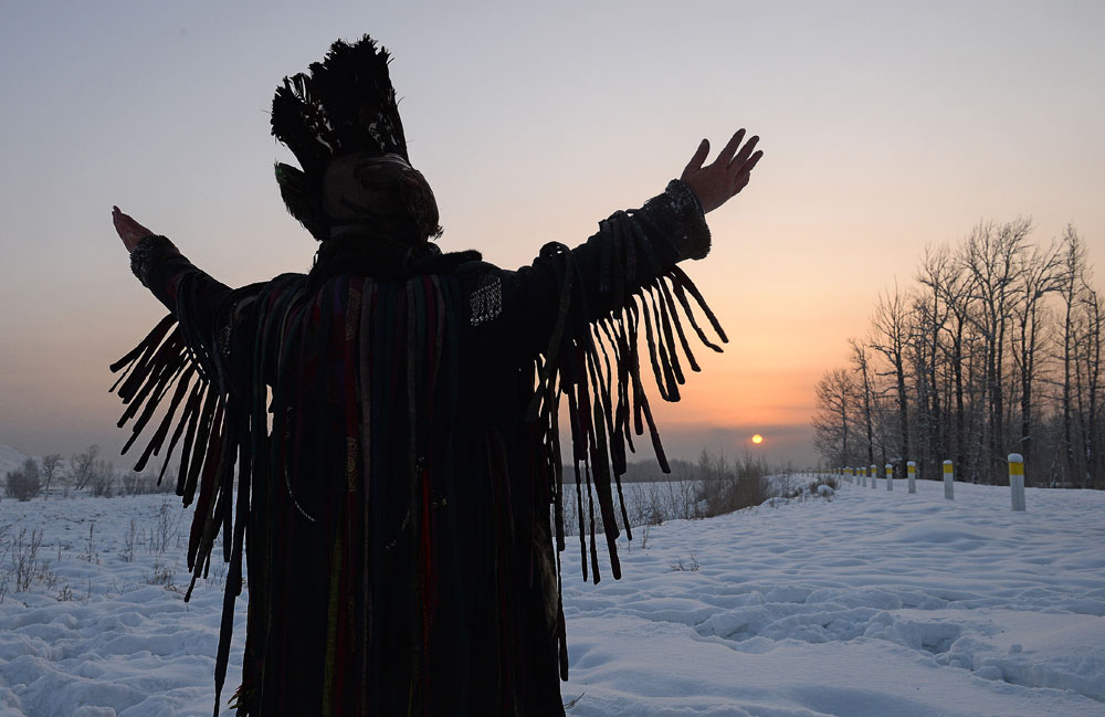 A shaman conducts the San Salyr rite at an ethnic park of culture and leisure on the bank of the Yenisei River in Kyzyl, the capital of Tyva. This rite welcomes the Sun whose first rays mark the beginning of Shagaa -- Lunar New Year.
