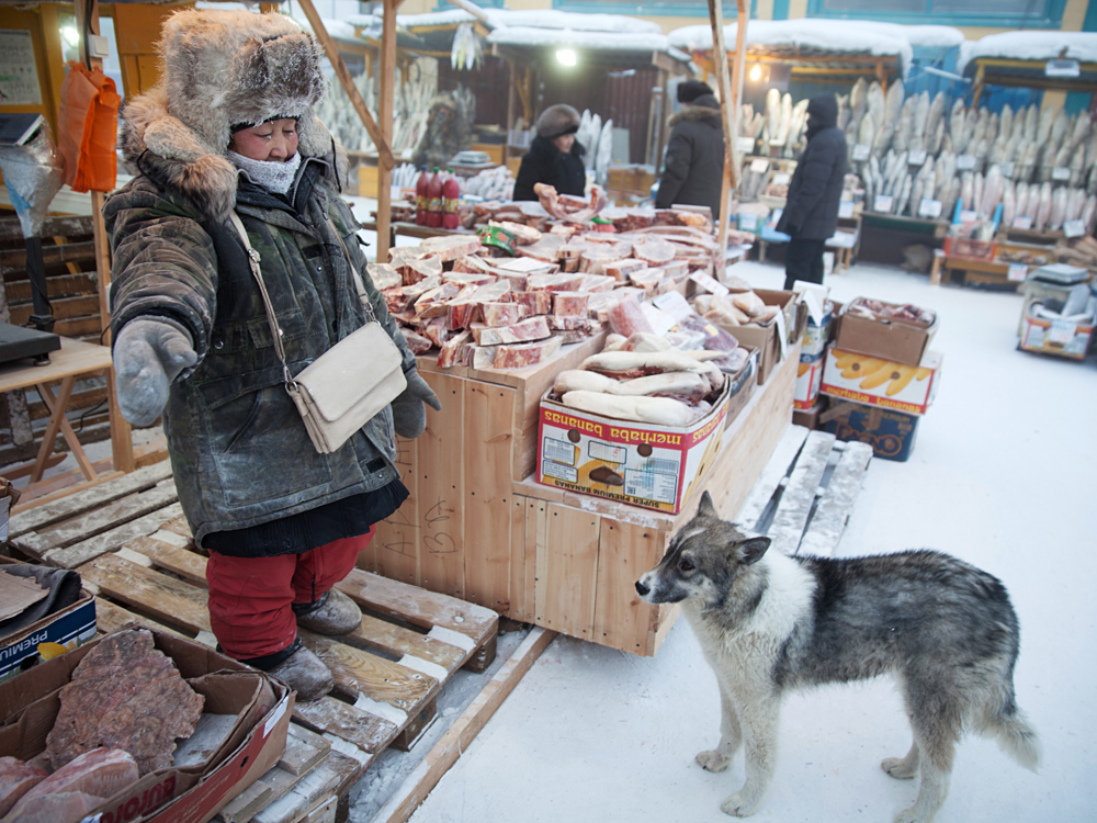 A stall selling meat at an outdoor food market in Yakutsk. Outdoor vendors brave -42 degrees Celcius while selling local frozen groceries.