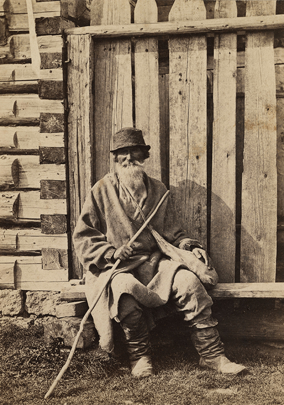 Apart from traditional portraits, William Carrick was one of the first Russian photographers to feature the life of ordinary people as subject matter. In the 1860s he created a series of 'street types', including hawkers, beggars, yard keepers, milkmaids, floor polishers, chimney sweeps, post-boys, policemen, cabmen, etc. / Beggar on the street, 1880 – 1870s.
