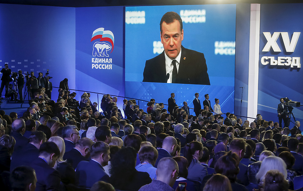 Russian Prime Minister Dmitry Medvedev is seen on a screen as he speaks at a United Russia party congress in Moscow, Feb. 6, 2016