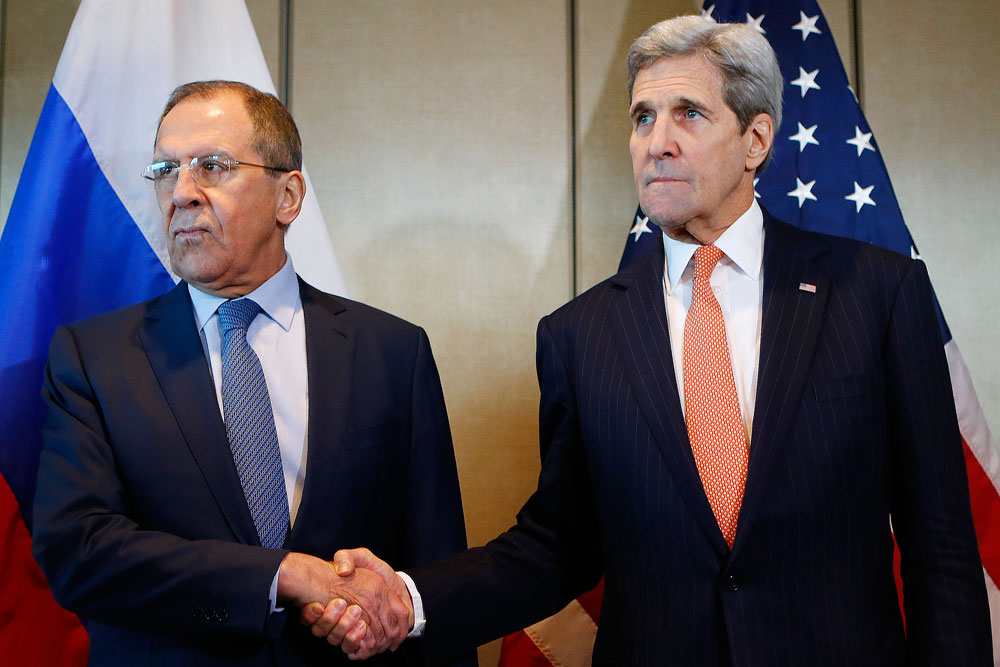 Russian Foreign Minister Sergey Lavrov, left, and U.S. Secretary of State John Kerry shake hands prior to bilateral talks in Munich, Germany.