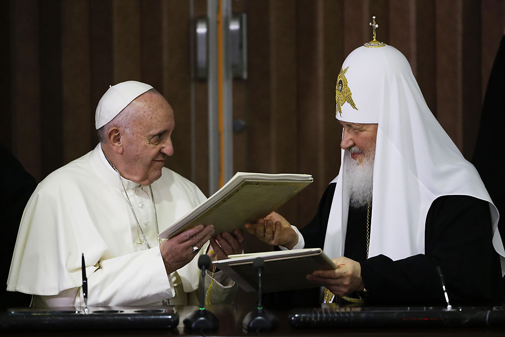 Pope Francis, left, and Russian Orthodox Patriarch Kirill exchange a joint declaration on religious unity in Havana, Cuba, 12, February 2016. Pope Francis and the leader of the Russian Orthodox Church, Patriarch Kirill, held a historic meeting in Havana's international airport. The two leaders signed a memorandum, which focused on ecumenism, or efforts to reunite Christian churches, common Christian values, and the persecution of Christians in the Middle East and Africa.