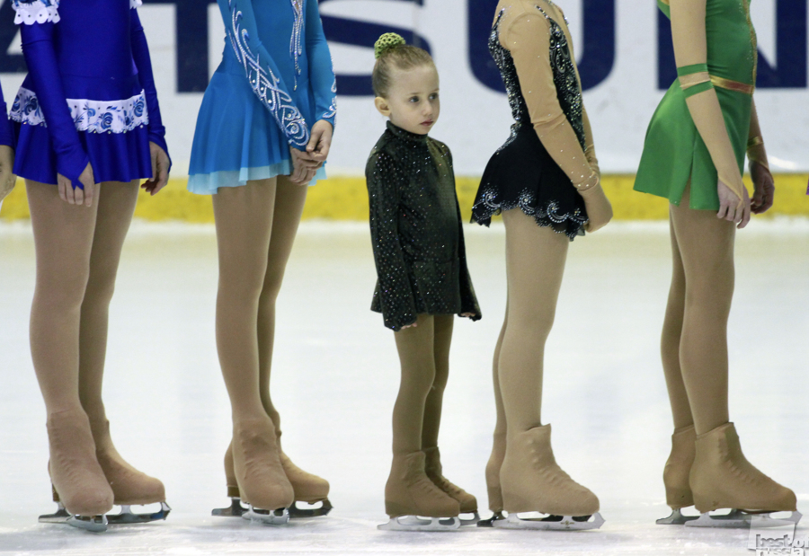 A young figure skater during a competition.