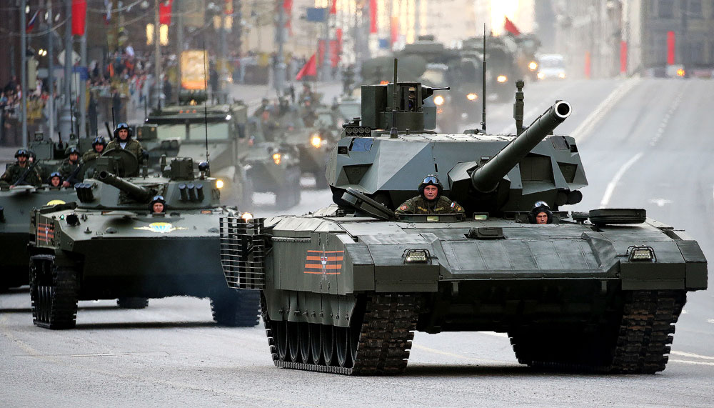 Armata battle tanks move along Tverskaya Street ahead of a Victory Day Parade rehearsal in Moscow's Red Square.