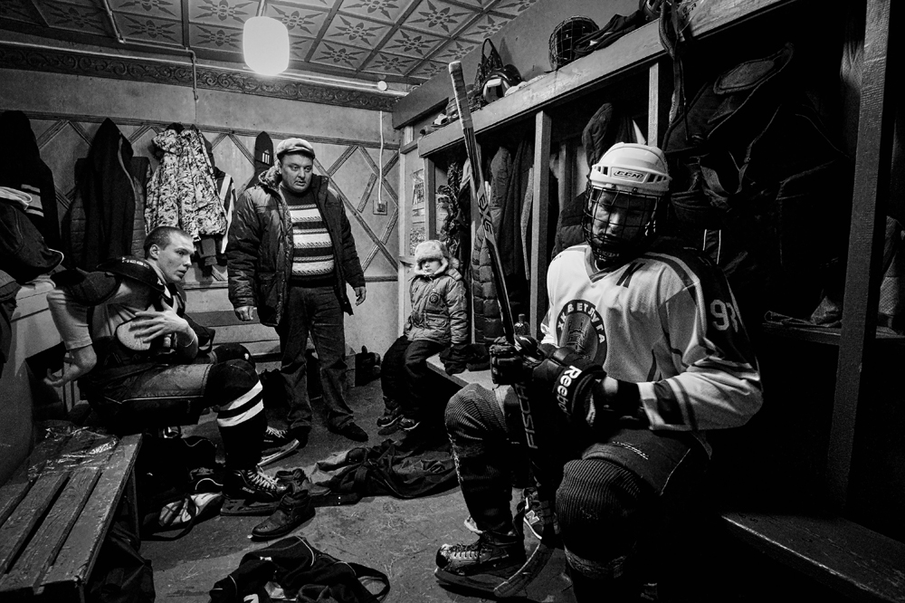 Players in the locker room of HC Vetluga at half-time.