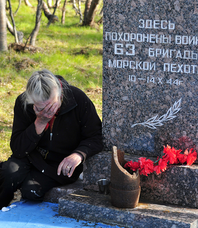 Meeting after many years apart. Sredny Peninsula, the Murmansk Region. A common grave for marines. A woman from Moscow at the place where her husband died.
