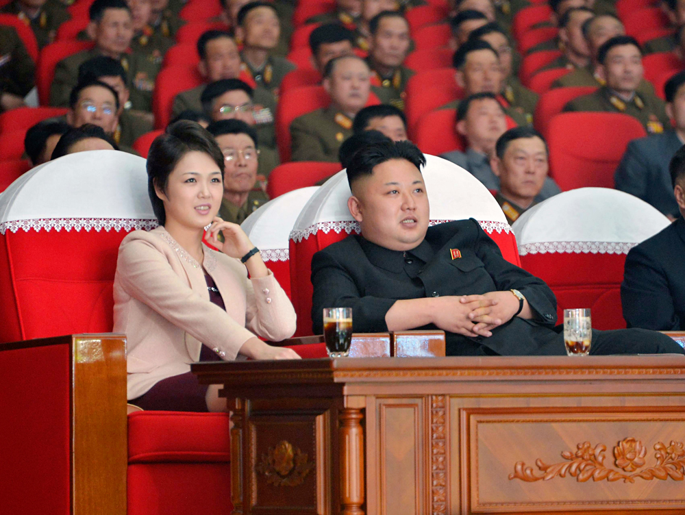 North Korean leader Kim Jong Un and his wife Ri Sol Ju watch a performance by the Moranbong Band at the April 25 House of Culture in this undated photo released by North Korea's Korean Central News Agency (KCNA) in Pyongyang on March 24, 2014.