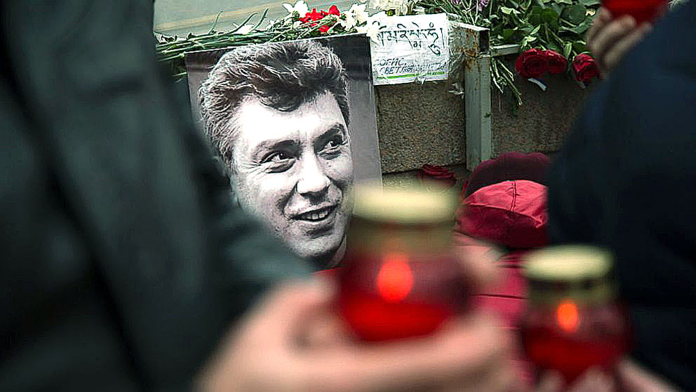 Mourners lay flowers and votive candles at the place where Boris Nemtsov was gunned down, in Moscow, on Feb. 27, 2015.