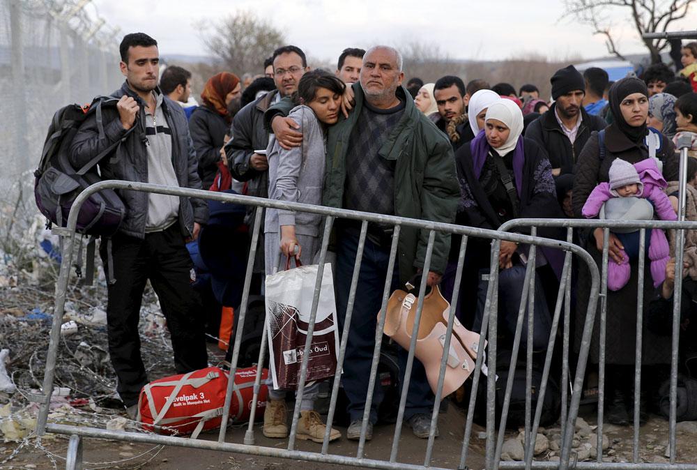 Syrische Flüchtlinge an der griechisch-mazedonischen Grenze.