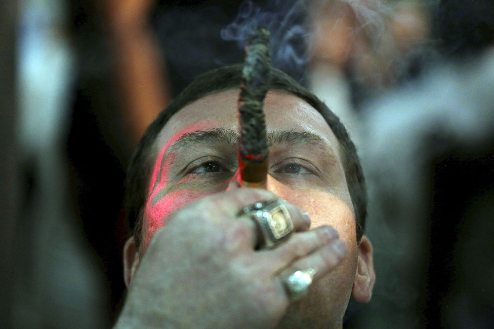 Actor Max Uralsky, from Russia, smokes as he competes for the longest ash during the XVIII Habanos Festival in Havana