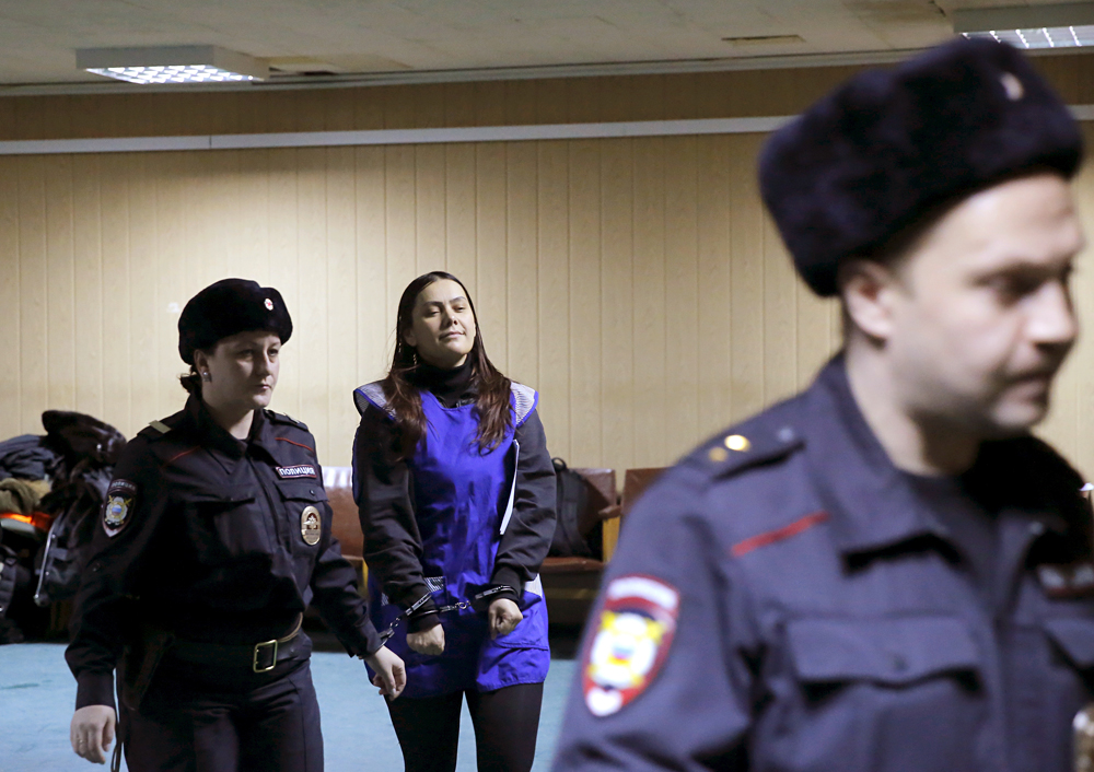 Gulchekhra (Gyulchekhra) Bobokulova, a nanny suspected of murdering a child in her care, is escorted inside a court building in Moscow, March 2, 2016