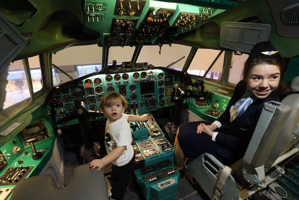 A boy in a pilot's cockpit at KidZania Moscow, a theme park where children can work in adult jobs, at Moscow's Aviapark shopping mall.