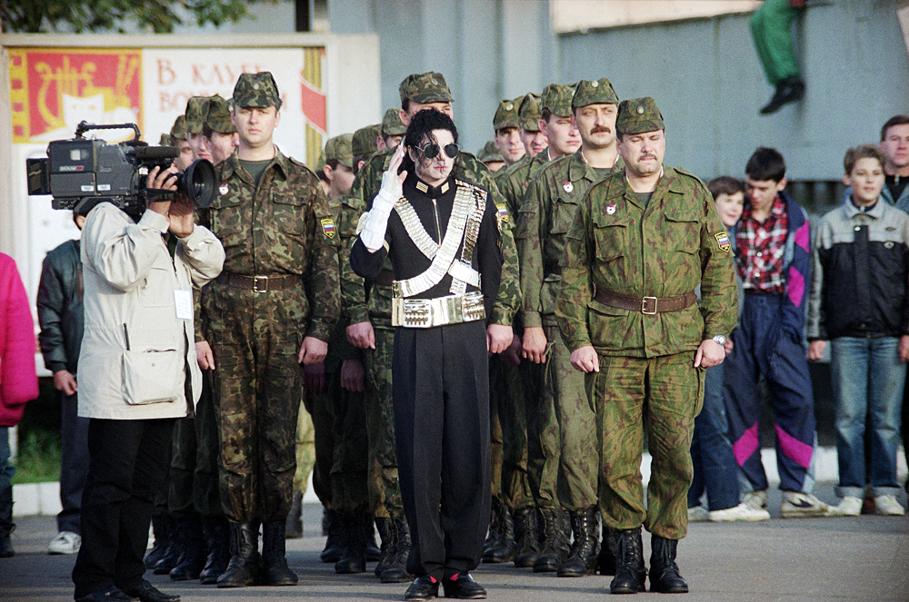 Pop star Michael Jackson marches with Russian Army soldiers at an army base in a suburb of Moscow, Sept. 14, 1993 during filming for an upcoming music video.